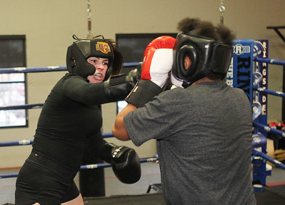 Candace H. Johnson-For Shaw Media Bella Crothers, 16, of Grayslake spars with Jeremiah Hernandez, 13, of Vernon Hills as she trains to fight in the Chicago Golden Gloves Finals in Cicero on April 13th at the Conquer Fight Club located inside the Libertyville Sports Complex.(4/5/18)