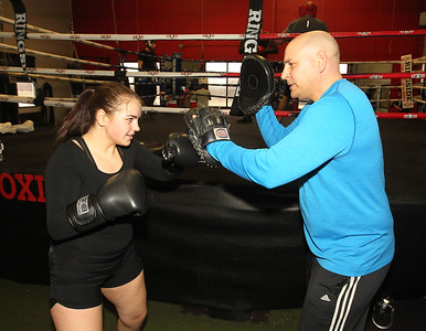 Candace H. Johnson-For Shaw Media Bella Crothers, 16, of Grayslake works with Coach Larry Lentz, of Round Lake Park, owner, on hand mitt training as she prepares to fight in the Chicago Golden Gloves Finals on April 13th in Cicero at the Conquer Fight Club located inside the Libertyville Sports Complex.(4/5/18)