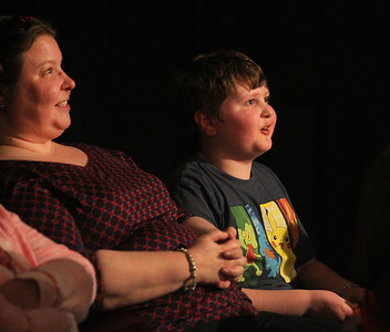Candace H. Johnson-For Shaw Media Birgitta Mackiewicz, of Peoria sits next to her son, John, 9, as he tells a fish joke to the actors performing on stage during the family friendly Improv Comedy Show at the Improv Playhouse in Libertyville. The Improv Comedy Show runs Saturday nights 7:30 pm-Family Friendly, 9:00 pm-Adult Friendly. (4/7/18)