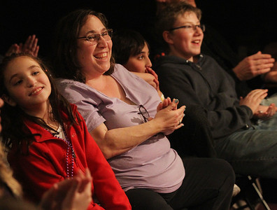 Candace H. Johnson-For Shaw Media Aubrey Masur, 10, of Buffalo Grove sits next to her mother, Marnie, twin brother, Sammy, and Charlie Plumhoff, 12, of Gurnee as they watch the family friendly Improv Comedy Show at the Improv Playhouse in Libertyville. The Improv Comedy Show runs Saturday nights 7:30 pm-Family Friendly, 9:00 pm-Adult Friendly. (4/7/18)