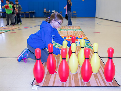 Riley Taubery (age 7) takes her turn at resetting the bowling pins Tuesday, April 10, 2018 at Ringwood Elementary in Ringwood. Part of a new Physical Education program, the equipment was donated by Steve Kuna owner of Johnsburg Bowl. KKoontz – For Shaw Media