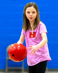 Summer Toussaint (age 7) practices her bowling skills Tuesday, April 10, 2018 at Ringwood Elementary in Ringwood. Part of a new Physical Education program, the equipment was donated by Steve Kuna owner of Johnsburg Bowl. KKoontz – For Shaw Media