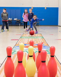 Riley Taubery (age 7) sends a ball down the lane Tuesday, April 10, 2018 at Ringwood Elementary in Ringwood. Part of a new Physical Education program, the equipment was donated by Steve Kuna owner of Johnsburg Bowl. KKoontz – For Shaw Media