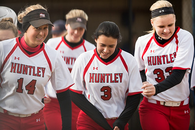 Whitney Rupp for Shaw Media Huntley's Cailyn Pienschke, left, Hali Marte, center, and Jacquelyn Dorn celebrate after a run against Dundee-Crown Tuesday, April 10.