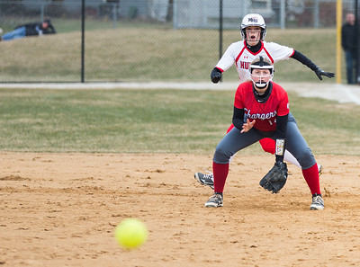 Whitney Rupp for Shaw Media Huntley's Marley Reicher sneaks behind Dundee-Crown's Kylie Ryza Tuesday, April 10 at Dundee-Crown. Huntley won 9-0.