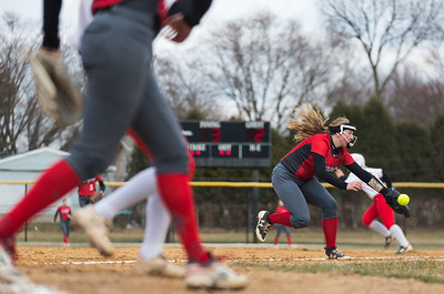 Whitney Rupp for Shaw Media Kylie Ryza of Dundee-Crown goes after the ball against Huntley Tuesday, April 10. The Red Raiders won 9-0.