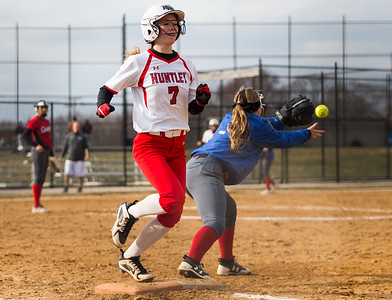 Whitney Rupp for Shaw Media Huntley's Autumn Kasal makes it to base behind Dundee-Crown's Kylie Ryza Tuesday, April 10.