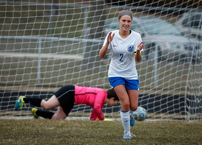 Camryn Tafoya (2) from Woodstock celebrates after scoring a goal on goalie Lindsy Restis (1) from Richmond-Burton during their overtime shootout at Woodstock High School on Wednesday, April 11, 2018 in Woodstock, Illinois. The Streaks won the shoot out 3-1 to beat the Rockets 2-1. John Konstantaras photo for Shaw Media