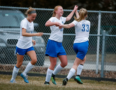 Juel Mecklenburg (10) from Woodstock celebrates her goal with Cameron Wormley (33) during the second half of their game against Richmond-Burton at Woodstock High School on Wednesday, April 11, 2018 in Woodstock, Illinois. The Streaks beat the Rockets 2-1 in an overtime shootout. John Konstantaras photo for Shaw Media