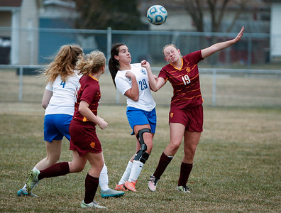 Jessica Flynn (29) from Woodstock and Mae Luce (19) from Richmond-Burton what to head a ball during the first half of their game at Woodstock High School on Wednesday, April 11, 2018 in Woodstock, Illinois. The Streaks beat the Rockets 2-1 in an overtime shootout. John Konstantaras photo for Shaw Media