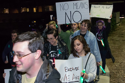 """Area residents participate in a march at McHenry County College in Crystal Lake Wednesday, April 11, 2018. The march is part of the 8th annual domestic violence and sexual violence awareness event """"Take Back the Night"""". KKoontz- For Shaw Media"""