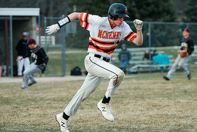 Jake Evans (21) from McHenry runs out a bunt for a hit during the sixth inning of their game against Prairie Ridge at Peterson Park on Thursday, April 12, 2018 in McHenry, Illinois. The Warriors defeated the Wolves 4-2. John Konstantaras photo for Shaw Media