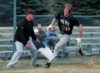 Roth Mizell (13) from Prairie Ridge heads home to score on a hit by Alexander Powers (21) during the sixth inning of their game against McHenry at Peterson Park on Thursday, April 12, 2018 in McHenry, Illinois. The Warriors defeated the Wolves 4-2. John Konstantaras photo for Shaw Media