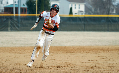 Nico Ghiselli (18) from McHenry heads to third base as he scores on a hit by Carter Foat (12) during the fourth inning of their game against Prairie Ridge at Peterson Park on Thursday, April 12, 2018 in McHenry, Illinois. The Warriors defeated the Wolves 4-2. John Konstantaras photo for Shaw Media