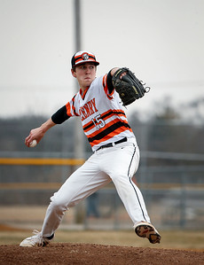 Joe Kaminski (15) from McHenry delivers a pitch in the first inning of of their game against Prairie Ridge at Peterson Park on Thursday, April 12, 2018 in McHenry, Illinois. The Warriors defeated the Wolves 4-2. John Konstantaras photo for Shaw Media