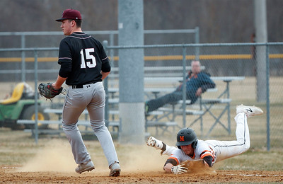 Jarod Wojcik (7) from McHenry grabs first base on a pick off play as Joseph Hansen (15) from Prairie Ridge waits for the ball during the first inning of their game at Peterson Park on Thursday, April 12, 2018 in McHenry, Illinois. The Warriors defeated the Wolves 4-2. John Konstantaras photo for Shaw Media