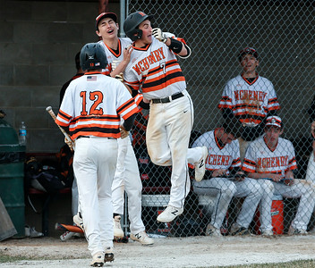 Jarod Wojcik (7) from McHenry celebrates at the dugout after hitting a sacrifice fly ball to score Carter Foat (12) during the sixth inning of their game at Peterson Park on Thursday, April 12, 2018 in McHenry, Illinois. The Warriors defeated the Wolves 4-2. John Konstantaras photo for Shaw Media