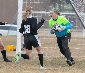 Woodstock North goalie Anicca Mackay-Slavin makes a save in the first half against Burlington Central Friday, April 13, 2018 in Woodstock. Burlington went on to win 5-1. KKoontz – for Shaw Media