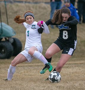 Woodstock North's Anastasia Mazzanti (left) and Burlington Central's Jessica Clouser battle over the ball Friday, April 13, 2018 in Woodstock. A tough Burlington Central goes on to win 5-1. KKoontz- For Shaw Media
