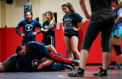Hannah Strauss, from Jacobs, watches as coaches demonstrate a move during an all-girl practice at Old School Wrestling Training Center on Friday, April 13, 2018 in Huntley, Illinois. John Konstantaras photo for Shaw Media