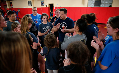 Coach Chris Klutz talks with wrestlers after an all-girl practice at Old School Wrestling Training Center on Friday, April 13, 2018 in Huntley, Illinois. John Konstantaras photo for Shaw Media