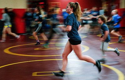 Hannah Strauss, from Jacobs, runs during a conditioning drill at the end of an all-girl practice at Old School Wrestling Training Center on Friday, April 13, 2018 in Huntley, Illinois. John Konstantaras photo for Shaw Media