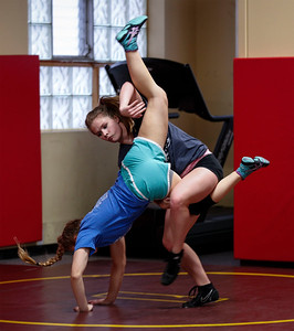 Hannah Strauss, from Jacobs, practices a takedown during an all-girl practice at Old School Wrestling Training Center on Friday, April 13, 2018 in Huntley, Illinois. John Konstantaras photo for Shaw Media