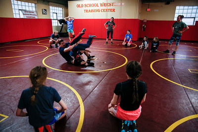 Wrestlers watch as their coaches demonstrate a move during an all-girl practice at Old School Wrestling Training Center on Friday, April 13, 2018 in Huntley, Illinois. John Konstantaras photo for Shaw Media