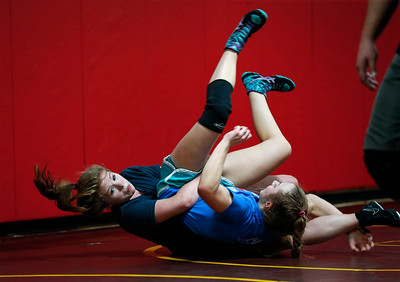 Hannah Strauss, from Jacobs, works on her technique during an all-girl practice at Old School Wrestling Training Center on Friday, April 13, 2018 in Huntley, Illinois. John Konstantaras photo for Shaw Media