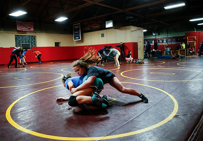 Hannah Strauss, from Jacobs, works during a takedown drill at an all-girl practice at Old School Wrestling Training Center on Friday, April 13, 2018 in Huntley, Illinois. John Konstantaras photo for Shaw Media