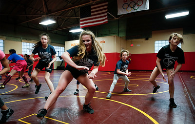 Hannah Strauss, from Jacobs, warms up during an all-girl practice at Old School Wrestling Training Center on Friday, April 13, 2018 in Huntley, Illinois. John Konstantaras photo for Shaw Media