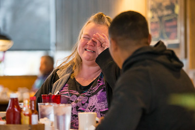 Whitney Rupp for Shaw Media Jennifer Stark wipes a happy tear from her face Sunday at Tony's Cafe in Crystal Lake. Stark's son, Tyler Stark, surprised his mom when he came home from Hawaii where he was stationed as a U.S. Marine.