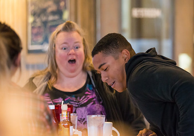 Whitney Rupp for Shaw Media Tyler Stark takes a seat at a table in Tony's Cafe Sunday as his mom, Jennifer Stark, is surprised to see her son. Tyler Stark surprised his mom when he came home from Hawaii where he was stationed as a U.S. Marine.