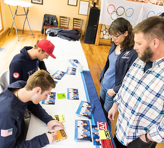 Whitney Rupp for Shaw Media Trish and Fred Kaiser, Crystal Lake, watch as Olympians Mike Glasder and Kevin Bickner sign autographs at Norge Ski Club Saturday, April 14.