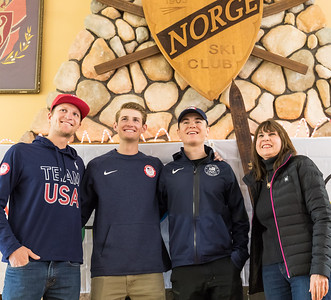 Whitney Rupp for Shaw Media Olympians Mike Glasder, Kevin Bickner and Casey Larson, from left, stand with Mary Bastien of Wauconda after autographing a wooden ski Bastien brought to a meet and greet in Fox River Grove Saturday, April 14.