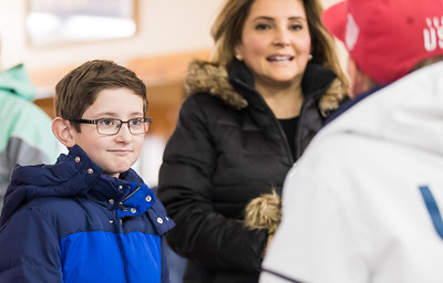 Whitney Rupp for Shaw Media Liam Thompson, 9, and mom Veronica Avedician of Cary visit with Olympian Mike Glasder in Fox River Grove Saturday.