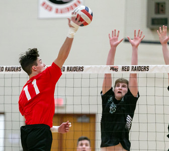 Huntley's Charlie Johnson puts down a spike against St. Edward Monday, April 16, 2018 at Huntley. St. Edward went on to win in three sets. KKoontz- For Shaw Media