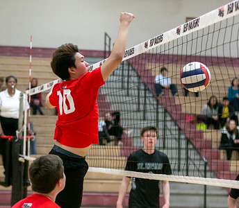 Huntley's Dan Park puts down a spike against St.Edward Monday, April 16, 2018 at Huntley. St. Edward went on to win in three sets. KKoontz- For Shaw Media