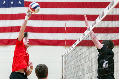 Huntley's Charlie Johnson puts down a spike against St.Edward Monday, April 16, 2018 at Huntley. St. Edward went on to win in three sets. KKoontz- For Shaw Media