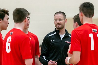 Huntley volleyball Head Coach Gerry Marchand talks with his players between sets Monday, April 16, 2018 in Huntley. The Red Raiders fell to St. Edwards in three sets. KKoontz- For Shaw Media