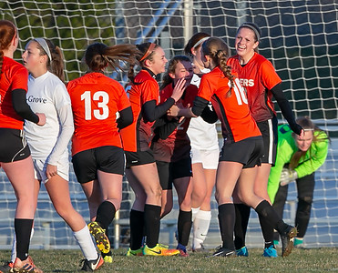 Crystal Lake Central players celebrate a goal by Grace Brickey against Cary-Grove Tuesday, April 17, 2018 in Cary. Cary went out to win 2-1. KKoontz – For Shaw Media