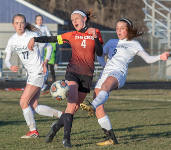 Cary-Grove's Kelli Ives (3) drives the ball past Crystal Lake Central's Elise Olson (4) Tuesday, April 17, 2018 in Cary. Cary went out to win 2-1. KKoontz – For Shaw Media