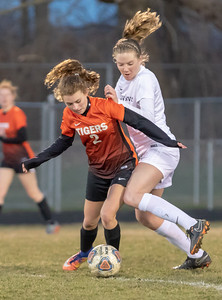 Crystal Lake Central's Grace Brickey (2) and Cary-Grove's Kailyn Sheehan battle for the ball Tuesday, April 17, 2018 in Cary. Cary went out to win 2-1. KKoontz – For Shaw Media