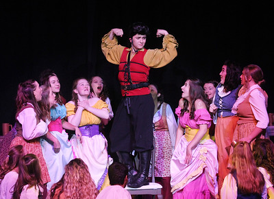 "Candace H. Johnson-For Shaw Media Gaston (Trey Romig) and the Villagers sing the song, ""Gaston,"" during dress rehearsal for Disney's Beauty and the Beast at Grant Community High School in Fox Lake. The musical will run April 19 & 20 at 7:00 pm and April 21 & 22 at 2:00 pm.(4/17/18)"