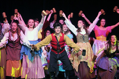 "Candace H. Johnson-For Shaw Media Gaston (Trey Romig) and the Villagers sing, ""Gaston,"" in the tavern during dress rehearsal for Disney's Beauty and the Beast at Grant Community High School in Fox Lake. The musical will run April 19 & 20 at 7:00 pm and April 21 & 22 at 2:00 pm.(4/17/18)"