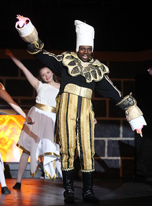 "Candace H. Johnson-For Shaw Media Chris Muntu, as Lumiere, sings, ""Be Our Guest,"" during dress rehearsal for Disney's Beauty and the Beast at Grant Community High School in Fox Lake. The musical will run April 19 & 20 at 7:00 pm and April 21 & 22 at 2:00 pm.(4/17/18)"