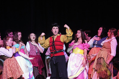 "Candace H. Johnson-For Shaw Media Gaston (Trey Romig) and the Villagers sing, ""Gaston,"" during dress rehearsal for Disney's Beauty and the Beast at Grant Community High School in Fox Lake. The musical will run April 19 & 20 at 7:00 pm and April 21 & 22 at 2:00 pm.(4/17/18)"