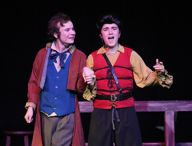 "Candace H. Johnson-For Shaw Media Le Fou (Kyle Knudsen) and Gaston (Trey Romig) sing the song, ""Gaston,"" during dress rehearsal for Disney's Beauty and the Beast at Grant Community High School in Fox Lake. The musical will run April 19 & 20 at 7:00 pm and April 21 & 22 at 2:00 pm.(4/17/18)"