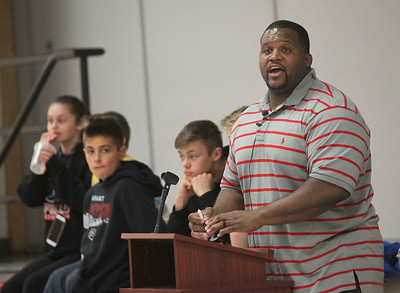 "Candace H. Johnson-For Shaw Media Anthony ""Spice"" Adams, former Chicago Bear and co-host of Inside the Bears, answers a question from a student while giving an inspirational talk about making good choices and his life on and off the football field at Stanton School in Fox Lake."