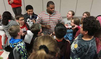 "Candace H. Johnson-For Shaw Media Anthony ""Spice"" Adams, former Chicago Bear and co-host of Inside the Bears, signs autographs for 5th-8th grade students after giving an inspirational talk about good choices and his life on and off the football field at Stanton School in Fox Lake. Adams signed his autograph on 318 pieces of paper to be given to every student in the school."